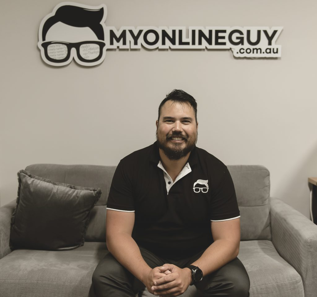 Jimmy Mitchell, founder of My Online Guy, sitting on a couch